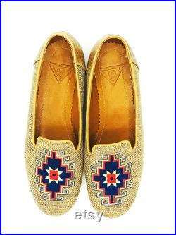 Tan shoe with blue and tan and blue accents and a leather sole